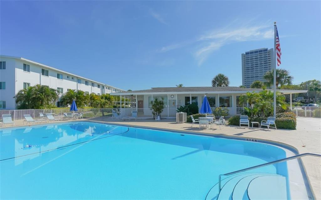Heated pool with clubhouse beyond - Condo for sale at 761 John Ringling Blvd #28, Sarasota, FL 34236 - MLS Number is A4490945