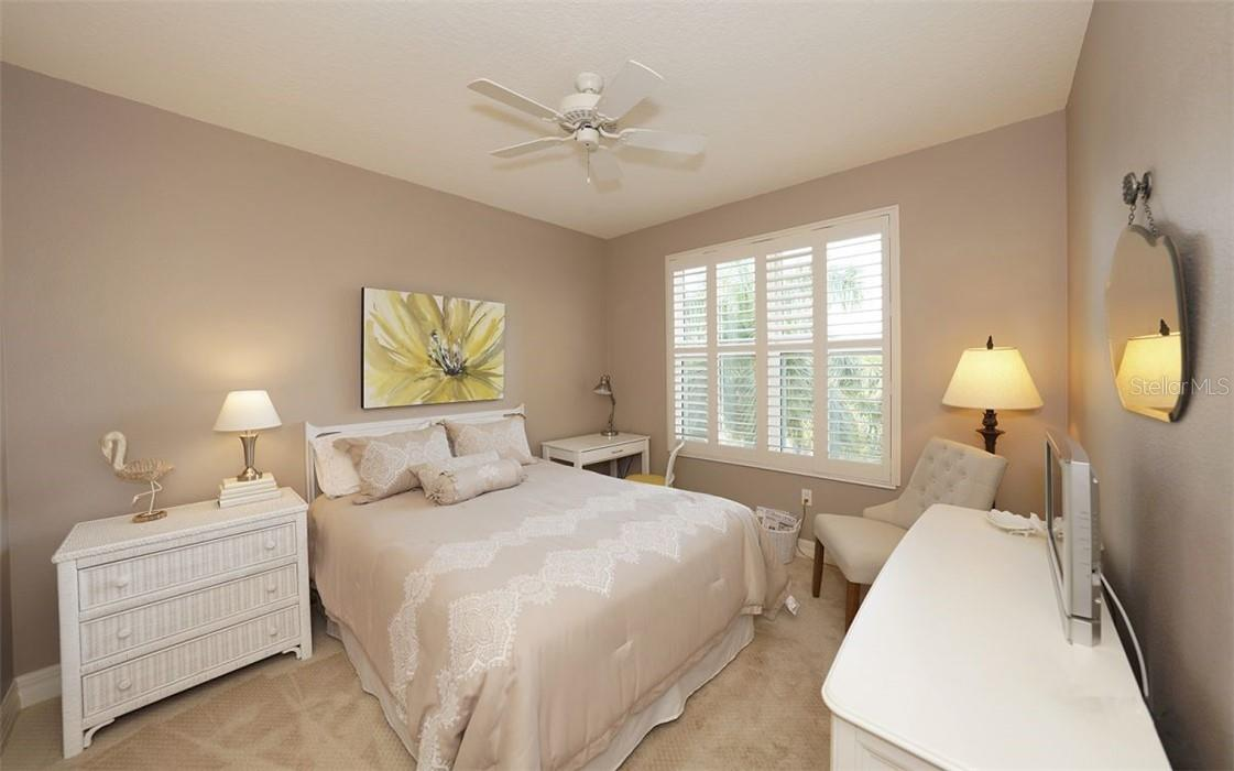 Lovely guest room with en suite bath - Condo for sale at 409 N Point Rd #402, Osprey, FL 34229 - MLS Number is A4491620