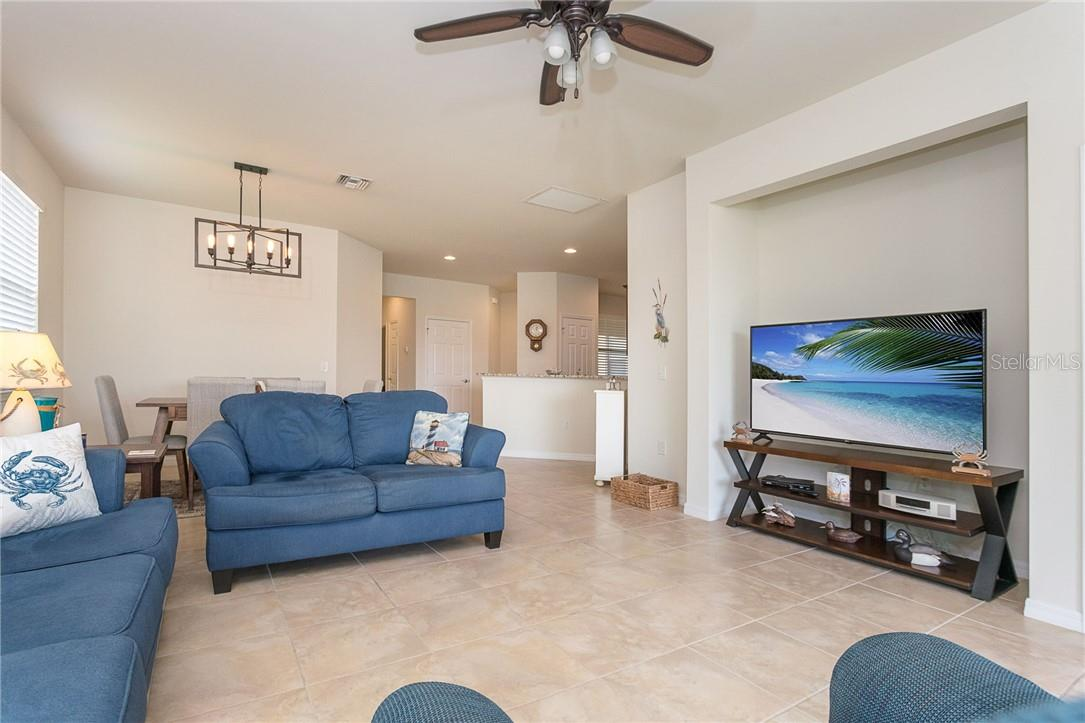 Open floor plan flows seamlessly with the outdoors - Villa for sale at 13883 Botteri St, Venice, FL 34293 - MLS Number is A4493523