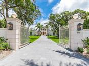 Gated Entrance to the Estate - Single Family Home for sale at 5050 Gulf Of Mexico Dr, Longboat Key, FL 34228 - MLS Number is A4104843