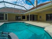 Pool, deck and outdoor covered area - Single Family Home for sale at 7607 Heathfield Ct, University Park, FL 34201 - MLS Number is A4154606