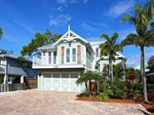 Single Family Home for sale at 119 Neptune Ln, Holmes Beach, FL 34217 - MLS Number is A4159005