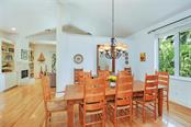Formal Dining Area with Wrought Iron Chandelier and View of the Tropical Gardens! - Single Family Home for sale at 722 Siesta Dr, Sarasota, FL 34242 - MLS Number is A4169257