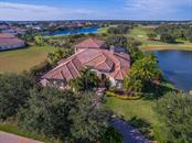 A rare, secluded Executive home on one of the premier lots in Founders' Club.  Golf course behind, pond on one side and beautiful park in front. Privacy can be all yours. - Single Family Home for sale at 3313 Founders Club Dr, Sarasota, FL 34240 - MLS Number is A4169443