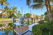 Trex composite dock includes 10,000 lb boat lift with electric service and fresh water, as well as programmable lift alarm.  Just moments away from the Sarasota Bay with no bridges to contend with! - Single Family Home for sale at 593 Rountree Dr, Longboat Key, FL 34228 - MLS Number is A4172941