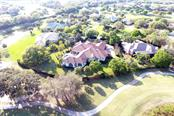 Magnificent, private Laurel Oak estate framed by Gary Player Designed East Course Holes 3 and 4 - Single Family Home for sale at 8130 Perry Maxwell Cir, Sarasota, FL 34240 - MLS Number is A4175735