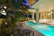 Community pool and lanai - Condo for sale at 501 Beach Rd #b, Sarasota, FL 34242 - MLS Number is A4175979