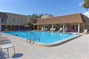 Beautiful pool and lounge chairs and Clubhouse. - Condo for sale at 1330 Glen Oaks Dr E #275d, Sarasota, FL 34232 - MLS Number is A4178649