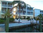 Step out your door and on to your private boat dock and community pool - Condo for sale at 9209 Midnight Pass Rd #5, Sarasota, FL 34242 - MLS Number is A4185067