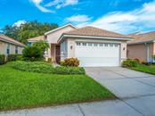Front exterior - Single Family Home for sale at 4294 Reflections Pkwy, Sarasota, FL 34233 - MLS Number is A4185695