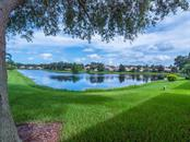 Back yard and lake views - Single Family Home for sale at 4294 Reflections Pkwy, Sarasota, FL 34233 - MLS Number is A4185695