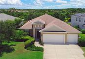 Aerial Front - Single Family Home for sale at 4840 Boston Common Gln, Bradenton, FL 34211 - MLS Number is A4187291