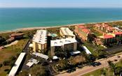 Aerial view Gulf side Island Reef Community - Condo for sale at 8770 Midnight Pass Rd #104b, Sarasota, FL 34242 - MLS Number is A4187603