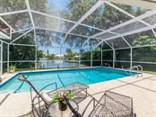 Serene setting aside the canal - Single Family Home for sale at 5303 Cape Leyte Dr, Sarasota, FL 34242 - MLS Number is A4188259
