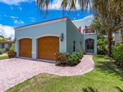 Beautiful curb appeal with two single 9-foot garage doors, pavered drive and front walkway. - Single Family Home for sale at 1884 Grove St, Sarasota, FL 34239 - MLS Number is A4189365