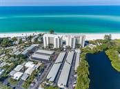 Aerial view of Whispering Sands looking towards Gulf of Mexico - Condo for sale at 19 Whispering Sands Dr #205, Sarasota, FL 34242 - MLS Number is A4189914