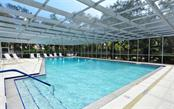 Caged heated pool - Villa for sale at 4248 Oakhurst Cir E #3066, Sarasota, FL 34233 - MLS Number is A4192258