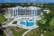 Wellness Center overlooking the lagoon with lockers, steam showers, massage room, state of the art equipment and a large outdoor terrace perfect for a morning yoga routine. - Condo for sale at 2251 Gulf Of Mexico #504, Longboat Key, FL 34228 - MLS Number is A4197085