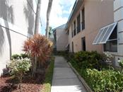 Front exterior - Condo for sale at 5661 Midnight Pass Rd #403, Sarasota, FL 34242 - MLS Number is A4198451