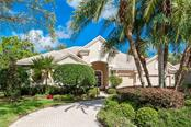 Pretty setting with circle drive. - Single Family Home for sale at 4887 Carrington Cir, Sarasota, FL 34243 - MLS Number is A4199511