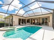 Large heated pool and spa. Bismarck palm centered on lanai. - Single Family Home for sale at 4887 Carrington Cir, Sarasota, FL 34243 - MLS Number is A4199511
