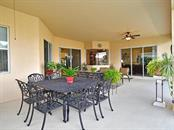 Ample living space under the covered porch to enjoy outdoors! - Single Family Home for sale at 6601 Horned Owl Pl, Sarasota, FL 34241 - MLS Number is A4205612