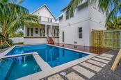 Saltwater Gas heated pool/spa with Keystone Coral coping and steppers - Single Family Home for sale at 580 Broadway St, Longboat Key, FL 34228 - MLS Number is A4205829
