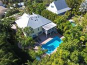 Aerial view of back of home and swimming pool - Single Family Home for sale at 141 Ogden St, Sarasota, FL 34242 - MLS Number is A4208039