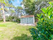 Back yard with Tuff shed with power - Single Family Home for sale at 411 Lyons Bay Rd, Nokomis, FL 34275 - MLS Number is A4209146