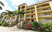 Building Front - Condo for sale at 8730 Midnight Pass Rd #400, Sarasota, FL 34242 - MLS Number is A4209312