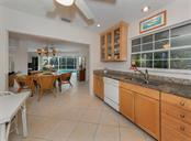 Kitchen to dining room - Single Family Home for sale at 445 Mahon Dr, Venice, FL 34285 - MLS Number is A4209507
