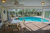 Covered patio/pool area - Single Family Home for sale at 600 Wild Turkey Ln, Sarasota, FL 34236 - MLS Number is A4210585