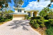 This classic John Cannon home situated in the peaceful, gated enclave of Siesta Estates is just a 10 minute walk to sunsets on Siesta Beach! - Single Family Home for sale at 5585 Siesta Estates Ct, Sarasota, FL 34242 - MLS Number is A4211109
