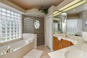 Master Bath with dual vanity features both a large soaking tub and separate glassed shower. - Single Family Home for sale at 5585 Siesta Estates Ct, Sarasota, FL 34242 - MLS Number is A4211109