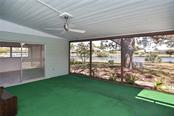Covered, screened lanai with canal views - Single Family Home for sale at 1953 Fairview Dr, Englewood, FL 34223 - MLS Number is A4213338