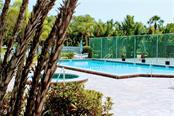 Resort style pool, spa, tennis and pickleball court. - Condo for sale at 1215 Dockside Pl #204, Sarasota, FL 34242 - MLS Number is A4215997