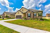 The beautiful stonework gives your home great curb appeal! - Single Family Home for sale at 13019 Utopia Loop, Bradenton, FL 34211 - MLS Number is A4404703