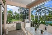 Gracious outdoor lanai with heated pool & spa. - Single Family Home for sale at 7309 Barclay Ct, University Park, FL 34201 - MLS Number is A4406768