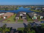 Exceptional Waterfront Location with long horizon view across Tidewater Lagoon and Manatee River to the right - Single Family Home for sale at 5511 Tidewater Preserve Blvd, Bradenton, FL 34208 - MLS Number is A4413764