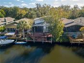 The 2 story home from the back on the large canal with it's levels of decking to your boat at the ready - Single Family Home for sale at 5214 S Riverview Cir, Homosassa, FL 34448 - MLS Number is A4414387
