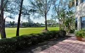 The expanse of the golf course opens up the rear of the home and provides privacy - Single Family Home for sale at 3529 Fair Oaks Ln, Longboat Key, FL 34228 - MLS Number is A4414992