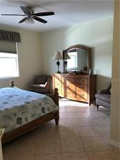 Owners Bedroom with window overlooking lanai. - Villa for sale at 252 Fairway Isles Ln, Bradenton, FL 34212 - MLS Number is A4417217