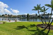 Large yard between residence and dock/waterfront - Single Family Home for sale at 7689 Cove Ter, Sarasota, FL 34231 - MLS Number is A4417242