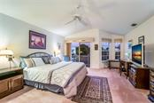 Master bedroom w/balcony overlooking canal - Single Family Home for sale at 4963 Oxford Dr, Sarasota, FL 34242 - MLS Number is A4417783