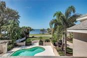 COVERED LANAI & POOL AREA - with Sarasota Bay/Sunset VIEWS - Single Family Home for sale at 5110 Sun Cir, Sarasota, FL 34234 - MLS Number is A4420424