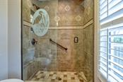 Guest Shower - Single Family Home for sale at 7791 Alister Mackenzie Dr, Sarasota, FL 34240 - MLS Number is A4422525