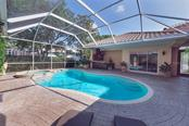 Courtyard pool/spa - gets plenty of sun yet loads of covered space! - Single Family Home for sale at 2972 Jeff Myers Cir, Sarasota, FL 34240 - MLS Number is A4424133