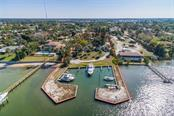 2.24 Acre Parcel with 175' frontage on Blackburn Bay with 18 Silp Marina.  Nearly all of RMF2 Parcel is x500 Flood Zone so Build up to 20 Units on Grade - Vacant Land for sale at 1649 Bayshore Rd, Nokomis, FL 34275 - MLS Number is A4426786