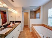 Master bathroom. - Single Family Home for sale at 2558 Oneida Rd, Venice, FL 34293 - MLS Number is A4428145