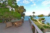 Open patio off the living room to enjoy the view of the bay. - Single Family Home for sale at 6841 Peacock Rd, Sarasota, FL 34242 - MLS Number is A4430828